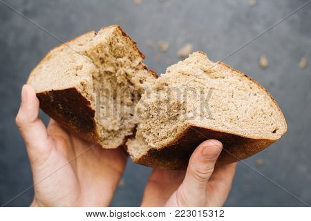 warm, freshly rye bread. Cut the slices. Tear off a piece with your hands. Farm food made from flour and eggs