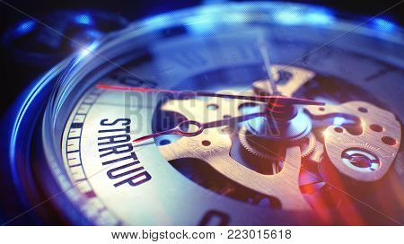 Startup. on Watch Face with CloseUp View of Watch Mechanism. Time Concept. Lens Flare Effect. Vintage Pocket Watch Face with Startup Phrase on it. Business Concept with Vintage Effect. 3D.