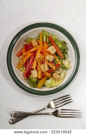 mediterranean paprika salad and croutons in a bowl