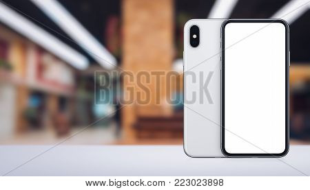 Similar to iPhone X smartphone mockup front and back sides on the desk in office space. Banner with copy space. 3D illustration.