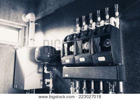 water heating pumps in boiler room