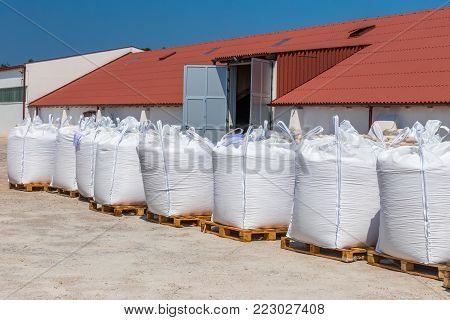 Factory for the production of sea salt. Raw material packed into sacks on wooden pallets.