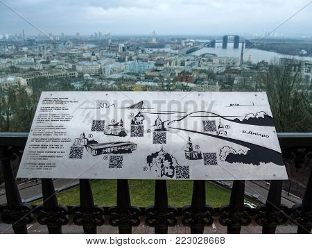 Kiev, Ukraine - December 31, 2017: Metal map of Kiev attractions on the background of the city panorama of Kiev. Map of the temples of the Ukrainian capital on the viewing platform of St. Andrew's Church