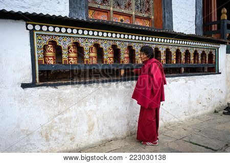 Thimphu, Bhutan - Aug 30, 2015. A Monk Praying At Monastery In Thimphu, Bhutan. It Is Believed That