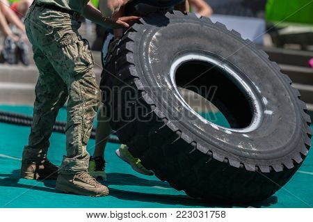 Soldiers Lift Huge and Heavy Truck Tire.