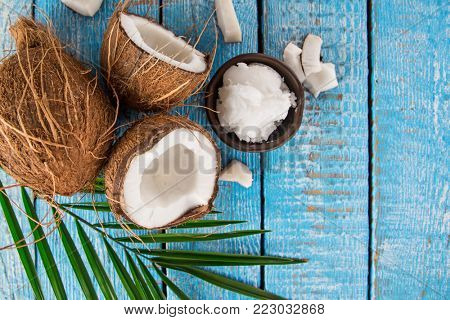 close-up of a coconuts, top view, old wooden background
