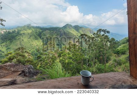 Breathtaking View From Top Mountain Cafe. Cup Of Coffe Under Blue Sky. Romantic Landscape At Tea Tim