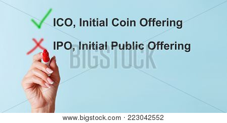 ISO vs IPO concept. The girl chooses Initial coin offering for funding the startup. Panoramic photo.