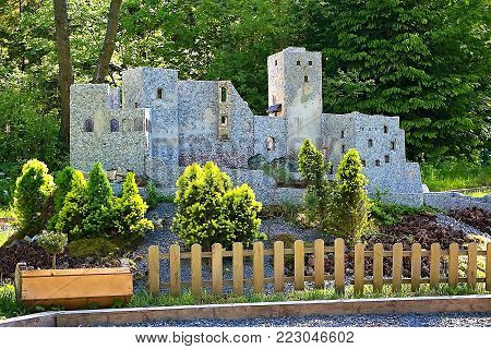 Liptovsky Jan, Slovakia - May 28. 2017: Miniature of the Strecno castle in the ratio 1 : 25. Castle, sun rays, trees and grass. Beautiful Slovakia