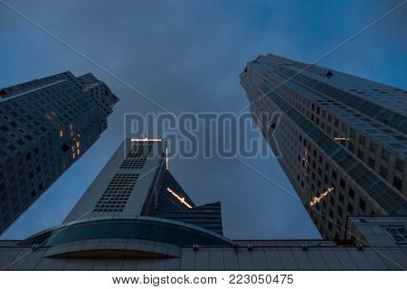 Singapore City, Singapore - 07 19 2015: High Skyscraper Business Buildings Agains Sky At Night.