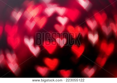 St Valentines day background with red light hearts. Defocused heart lights as symbols of St Valentines day, festive St Valentines day background