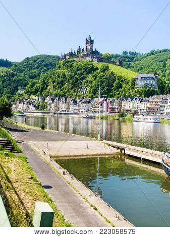 COCHEM, GERMANY - JUNE 28, 2010: view of Cochem city with Reichsburg Cochem castle on Moselle riverbank in summer day. Cochem is the biggest town in the Cochem-Zell district in Rhineland-Palatinate