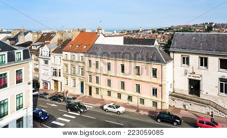 BOULOGNE-SUR-MER, FRANCE - JULY 1, 2010: above view of people near sub-prefecture on street Grande Rue in Boulogne-sur-Mer city from fortified wall of old citadel in summer evening