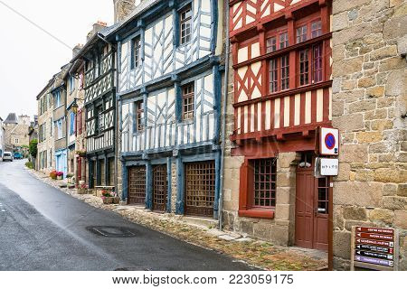 TREGUIER, FRANCE - JULY 2, 2010: Rue Ernest Renan street with old half-timbered houses in Treguier town. Treguier is port town in the Cotes-d'Armor department in Brittany.