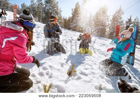 Young friends snowballing and enjoying