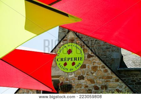 ILE-DE-BREHAT, FRANCE - JULY 4, 2010: facade of traditional Creperie restaurant in Brehat. Ile-de-Brehat is island and commune located near Paimpol town, a mile from the northern coast of Brittany