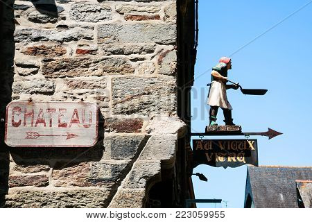 VITRE, FRANCE - JULY 7, 2010: street sign to the side of the castle (chateau) in Vitre old town. Vitre is a commune in the Ille-et-Vilaine department in Brittany in northwestern France
