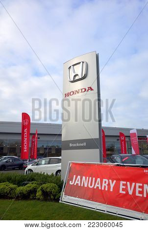 Bracknell,England - January 22, 2018: Signs and vehicles in front of the Honda Car Dealership in Bracknell, England. The Honda Motor Company was incorporated in Japan in 1948