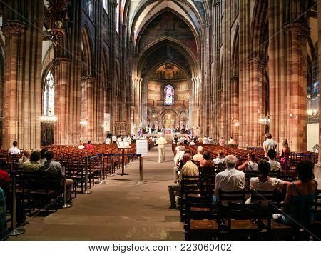 STRASBOURG, FRANCE - JULY 10, 2010: people during church service in Strasbourg Cathedral . Roman Catholic cathedral was built in 1015-1439 years in Romanesque and Gothic styles