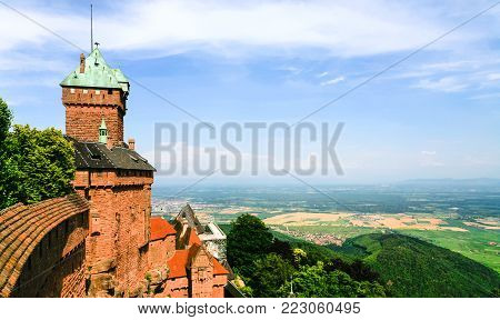 ORSCHWILLER, FRANCE - JULY 11, 2010: view of castle Chateau du Haut-Koenigsbourg and plain lands of Alsace. First time the castle was mentioned in 1147, building was restored and rebuilt in 1900-1908