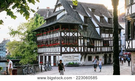 STRASBOURG, FRANCE - JULY, 11: people near medieval house Maison des Tanneurs in Petite France quarter of Strasbourg city. Strasbourg is capital of Grand Est region and Bas-Rhin departement in Alsace