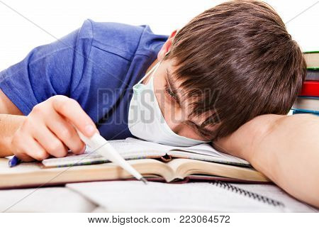 Sad and Sick Student with Thermometer and Books on the on the School Desk