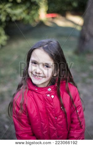Portrait Of A Little Girl Of 7 Years On The Outside