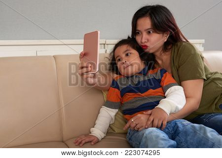 Filipino mother and son taking funny selfies
