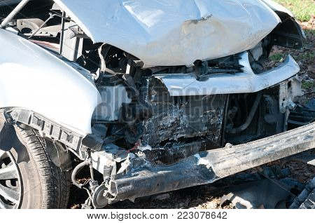 Car crash damage. Front side of broken and damaged car wreck in crash accident with fatal outcome in collision
