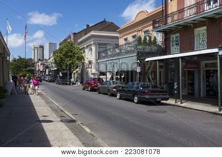 New Orleans, Louisiana - June 17, 2014: View of a street with tourists in the French Quarter in the city of New Orleans, Louisiana, USA