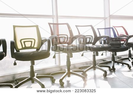 Luxury office furniture. Office chairs on window background.