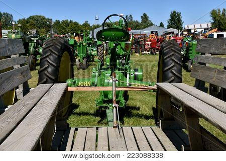 DALTON, MINNESOTA, Sept 9, 2017:  A John Deere tractor hooked to a people hauler are ready for usage at the annual Dalton Threshing Show held each third weekend of September