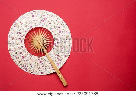 Japanese folding fan isolated on white background
