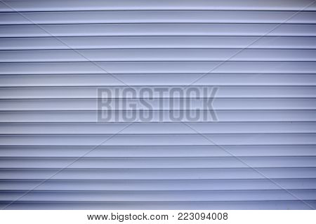 Closed Plastic blinds on the window with sunlight