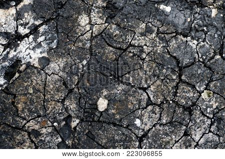 Texture, background, seamless pattern. This is useful for designers. Bitumen resin crack from the heat of the solar wind. Solid or viscous organic compound substance used in road construction