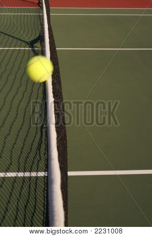 Tennis Ball In Motion Hitting Net