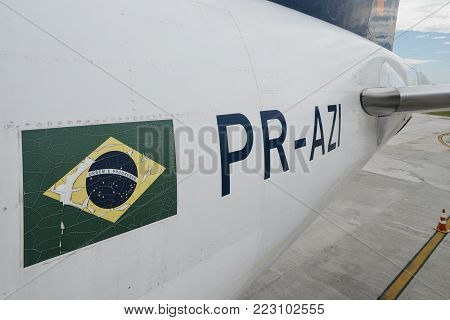 Santos Dumont Airport, Rio de Janeiro, Brazil - Dec 22, 2017: Close up for a Brazilian flag and airplaner identifer on an airplanet parked at Rio de Janeiro's Santos Dumont airport
