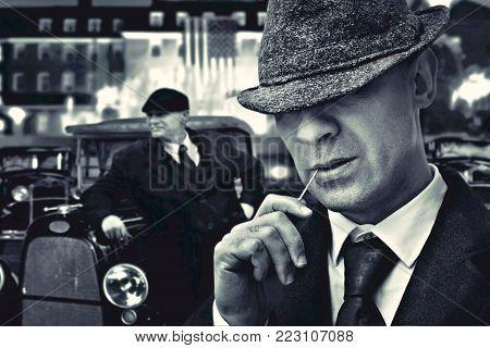 vintage bossy Italian mafia gangster in 1930's near classic car
