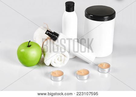 Natural spa beauty treatment cleansing products with apple on white background. The concept for advertising cosmetics. Still life. Copy space
