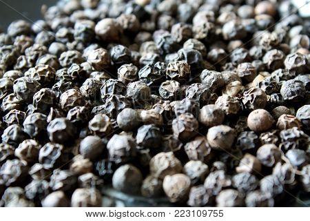 Black pepper background. extreme close up shot