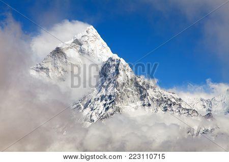Mount Ama Dablam within clouds, way to Everest base camp, Khumbu valley, Sagarmatha national park, Everest area, Nepal