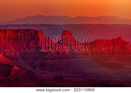 Landscape view of geological rock formations in southwest Utah from a high overlook at sunset