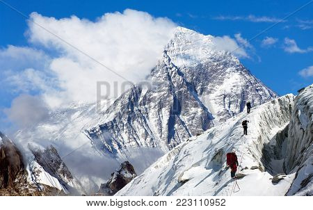 view of Everest from Gokyo valley with group of climbers on glacier, way to Everest base camp, Sagarmatha national park, Khumbu valley, Nepalese Himalayas