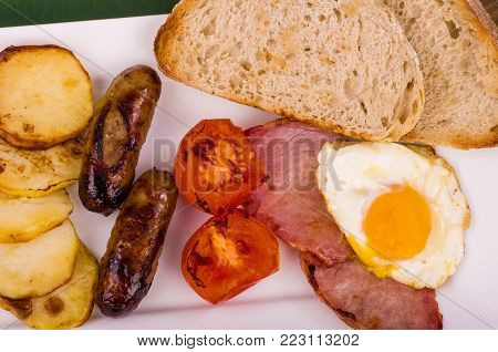 Ulster Fry Breakfast.A large fried breakfast served with toasted Sourdough bread. (The fried potato is known as Pan Haggerty)