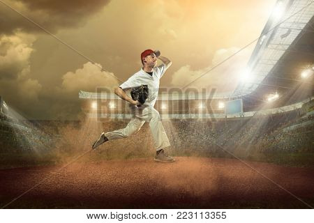 Baseball player in dynamic action on the stadium.