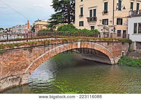 Adria, Rovigo, Veneto, Italy: ancient bridge over the river Canalbianco in the old town of the city near the Po Delta Park