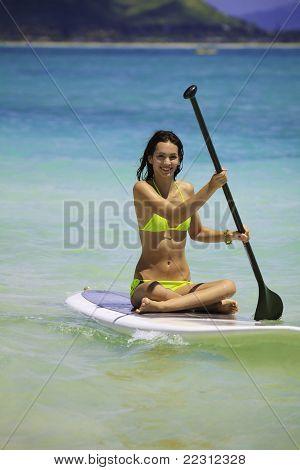 woman on a standup paddle board