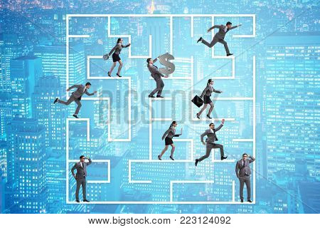 Business people getting lost in maze uncertainty concept