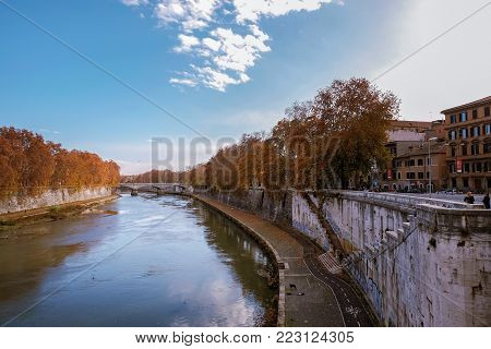 Sunny day in Rome, Italy. View of Tiber river and bridge.