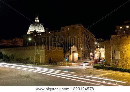 Rome, ITALY - November 9 2017: San Pietro dome and the remains of Porta Cavallegeri, one of the gates of the Leonine wall in Rome. ROME, November 9 2017